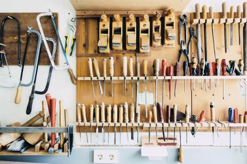 Organizing garages - Tools neatly hung over a workbench
