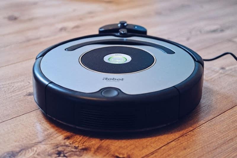 Organizing Bedrooms - Robot vacuum on hard wood floor