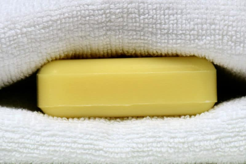 Organizing Linen Closets - A bar of soap tucked between folded towels