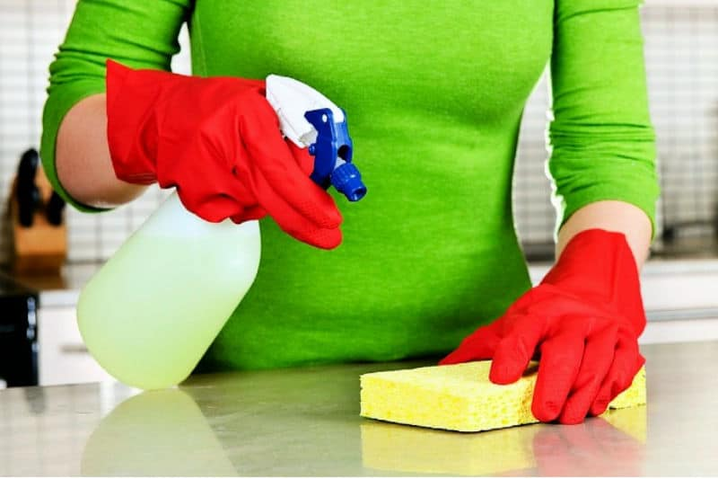 Woman cleaning a kitchen counter