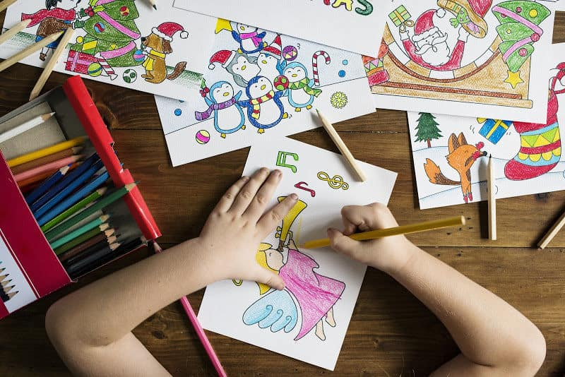 Get an Organized and Clean House - Child coloring at a table in the family room