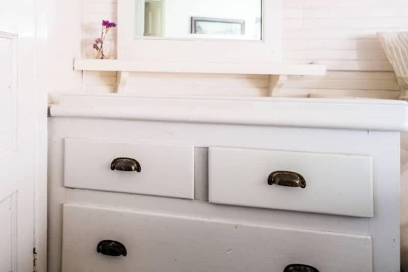 Organize kids dressers - White wood dresser with dark modern drawer pulls