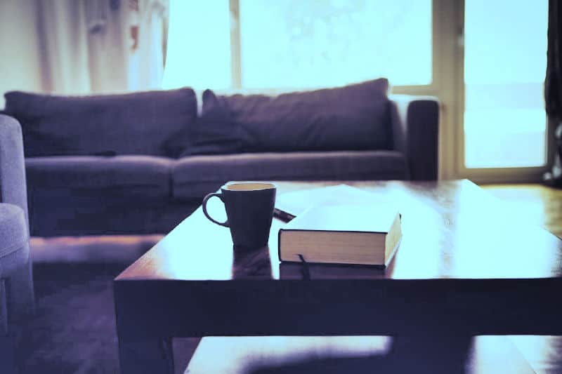 Clutter hot spot - coffee table with a book, newspapers and tea sitting out