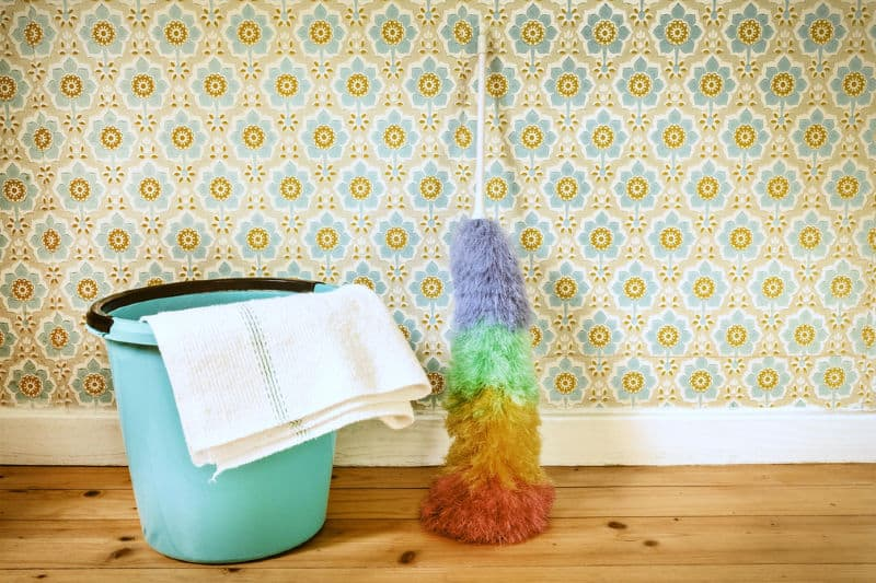 Cleaning bucket and duster leaning against wall