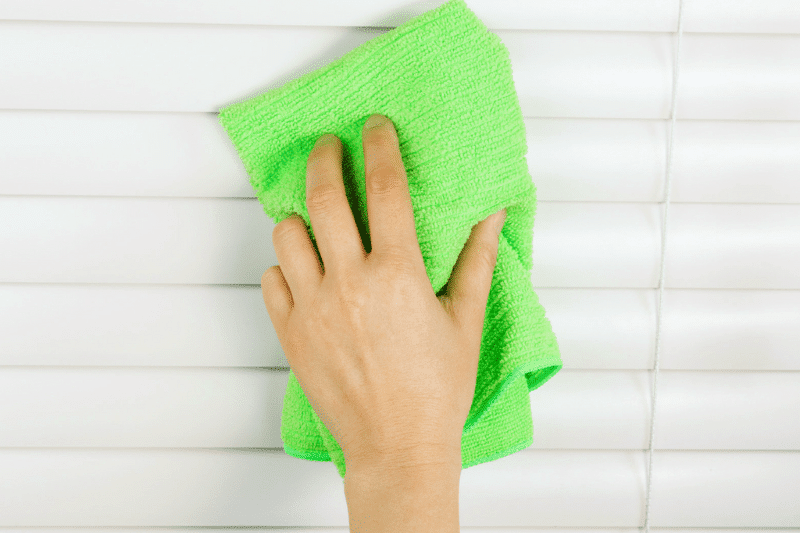 Cleaning vinyl blinds with a microfiber cloth