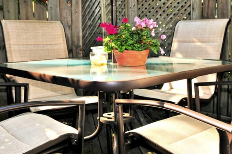 Patio table and chairs with potted plant