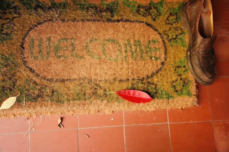 Welcome mat and shoe at door to keep carpets clean