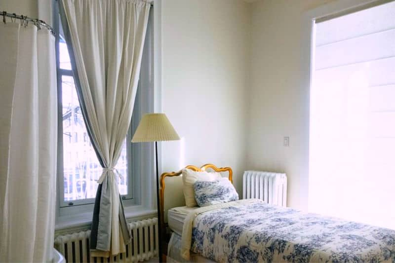 Bedroom with white silk curtains