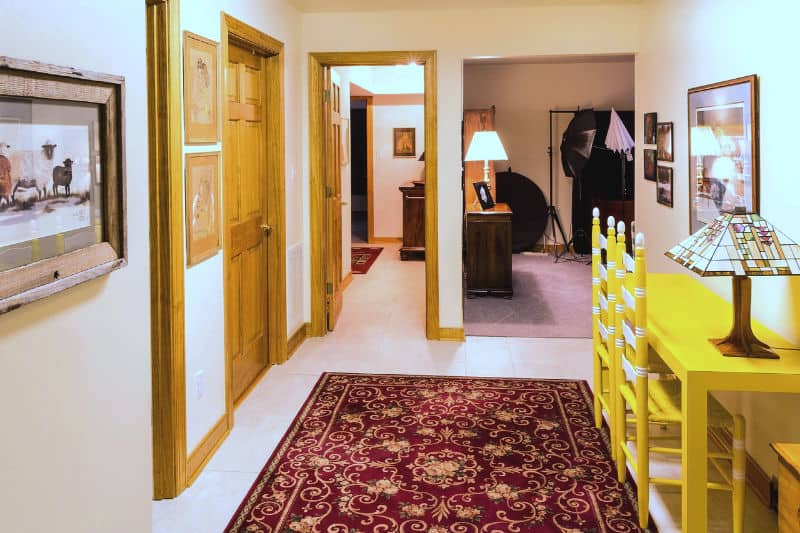 Yellow chairs at a table in an organized entryway