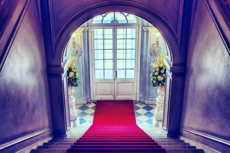 Red carpet leading upstairs from front door