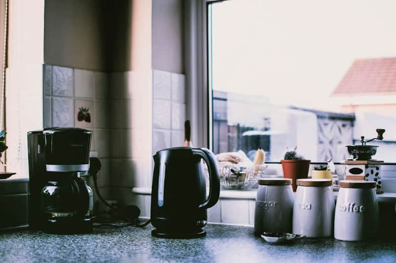 Coffee maker and electric kettle on counter