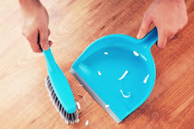 Things Clean People Do Daily - Picking up messses on floor with hand broom and dust pan