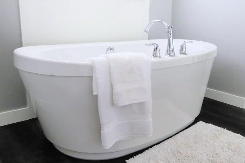 Clean white bathtub with no soap scum