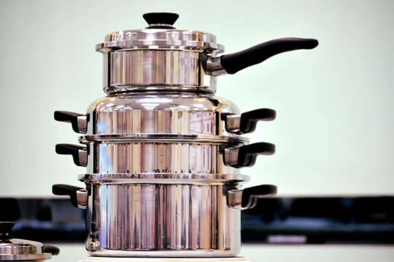 Stack of metal pots and pans