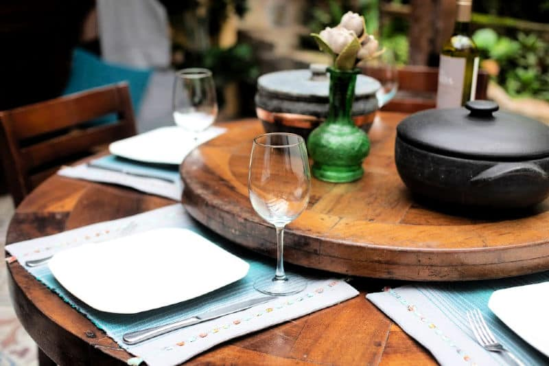 Round wood dining table with lazy susan