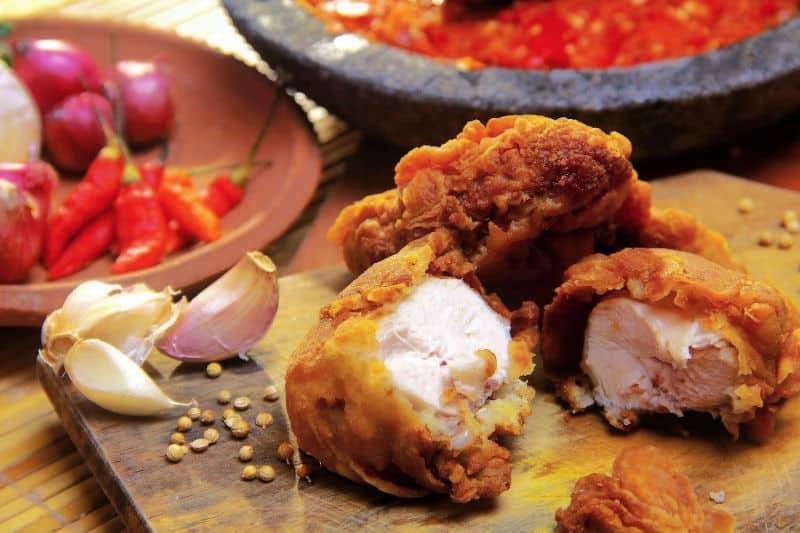 Fried chicken on a wood cutting board