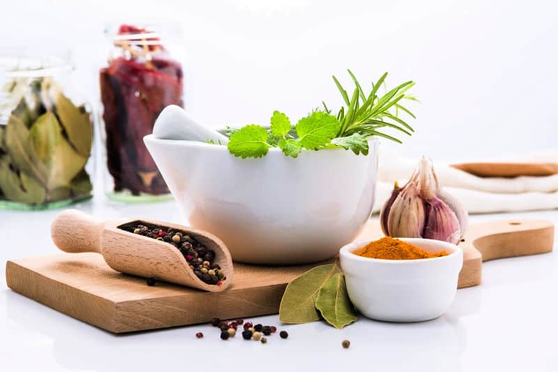 Spices and herbs in mortar with pestle