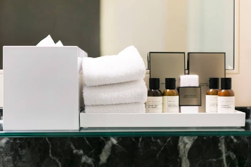 Toiletries and spare towels organized in guest bathroom