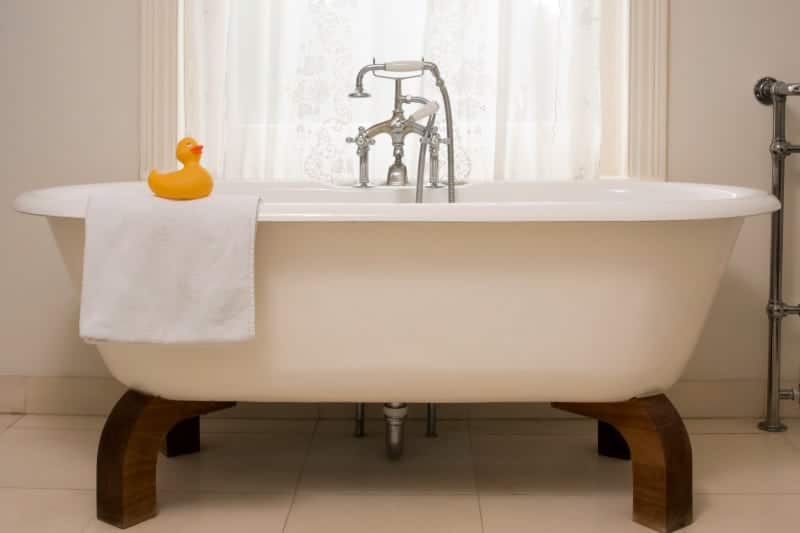 Clean bathtub with towel and rubber duck
