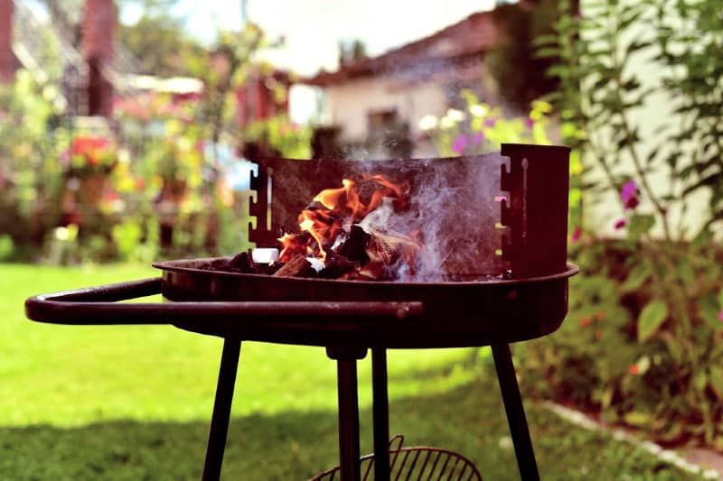 dirty barbeque grill with wood kindling