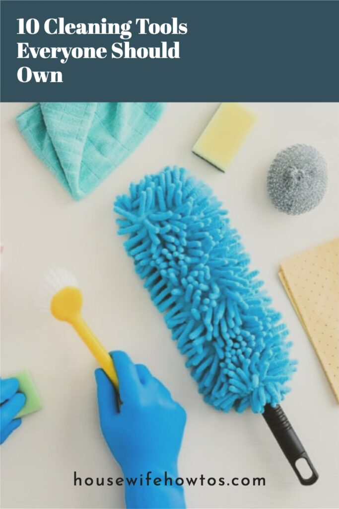 """Overhead image of hand in rubber glove holding scrub brush and other cleaning essential supplies with text overlay that reads """"10 Cleaning Tools Everyone Should Own"""""""