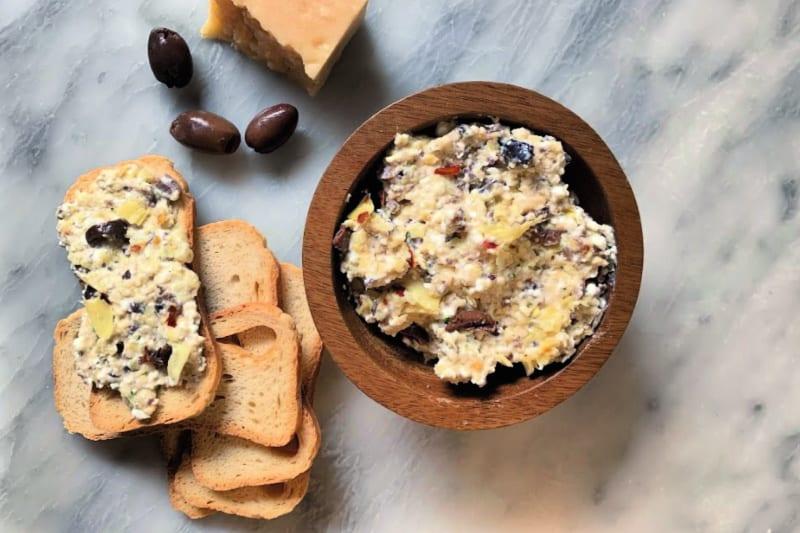 Artichoke and Kalamata Olive Dip recipe spread on Melba toast