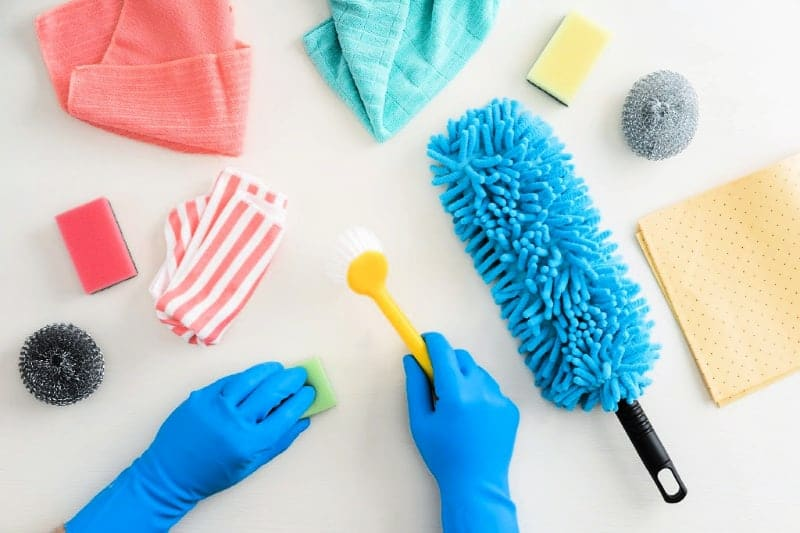 Essential cleaning tools on a white background