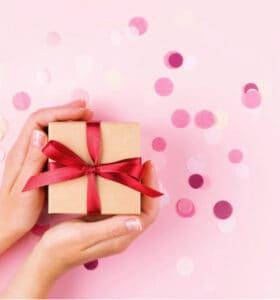 Hostess holding gift