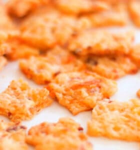 Bacon Garlic Cheddar Crackers Recipe cooling on parchment paper