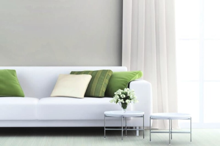 Clean white sofa in a minimalist living room