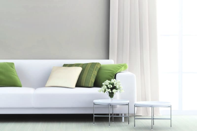 Clean white sofa in minimalist living room