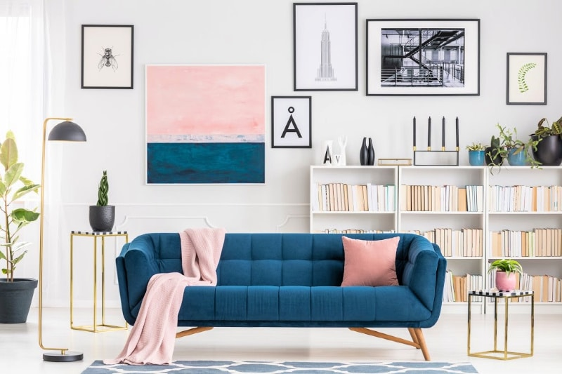 Pink and blue accents in a modern clean living room house interior