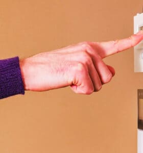 Lowering the thermostat to save money on utility bill