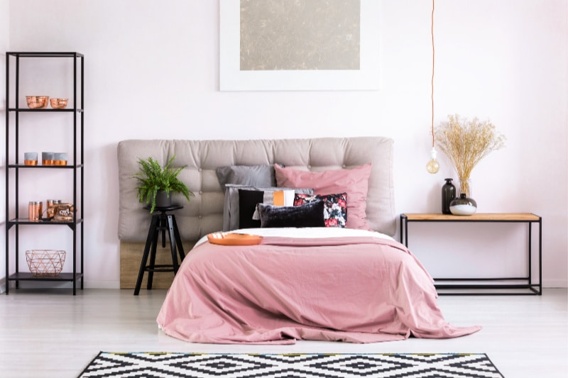 Queen sized bed with pink cover in making bed challenge