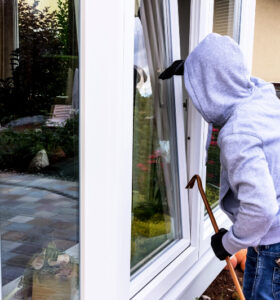 a burglar attempts at an open window with a crowbar brea