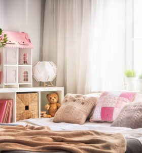 Interior of light kids bedroom for child girl.