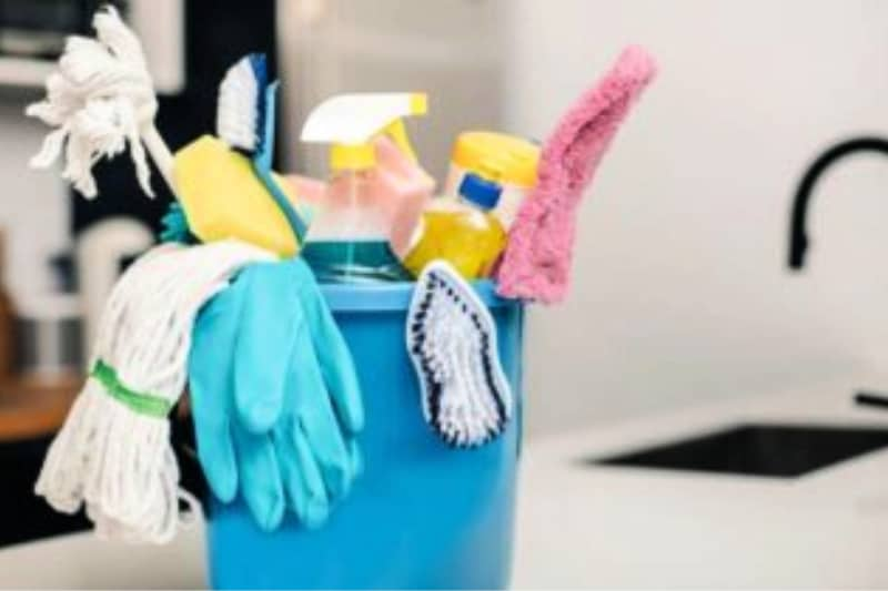 Bucket of cleaning supplies on kitchen counter