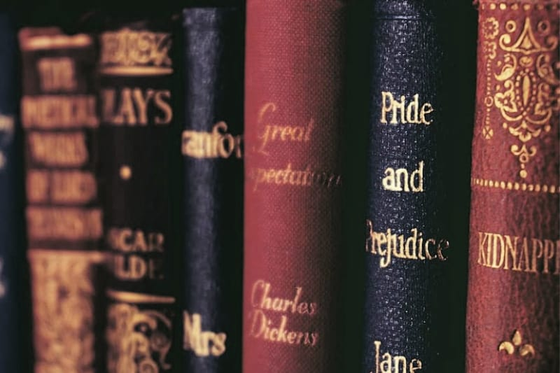 Hardbound books with titles in gilt letters