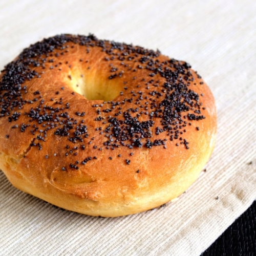 Closeup of poppy seed homemade bagel on a napkin