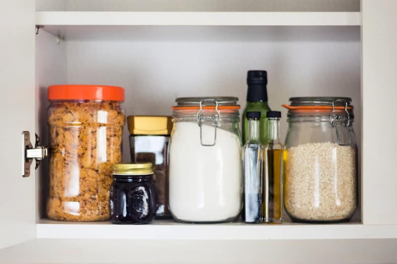 Clean pantry shelf with dry goods in jars