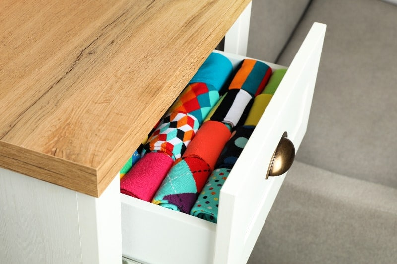 Neatly folded socks in an open drawer