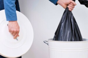 Person emptying trash can