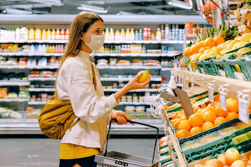 Woman wearing cloth mask at grocery store