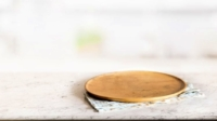 Clean and oiled round wood cutting board for cheese sitting on counter