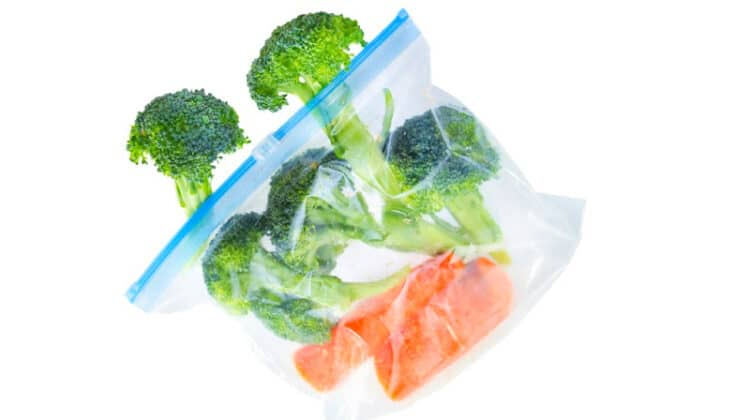 Broccoli florets and halved carrots in a ziploc bag