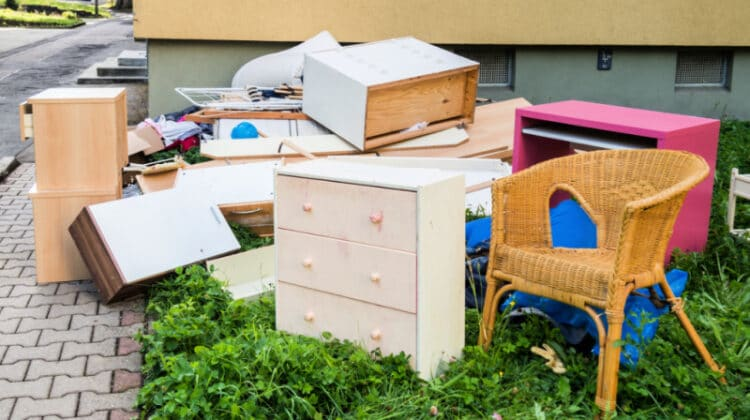 Old furniture and junk on the curb after someone decluttered