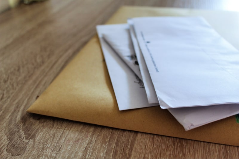 Pile of mail growing on the table shows a bad cleaning habit