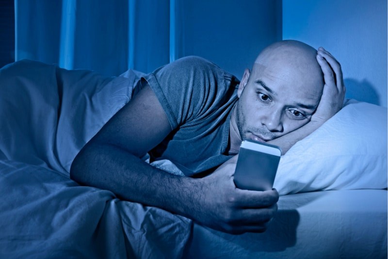 Man in bed woken by glowing phone shows why you should not keep them in your bedroom