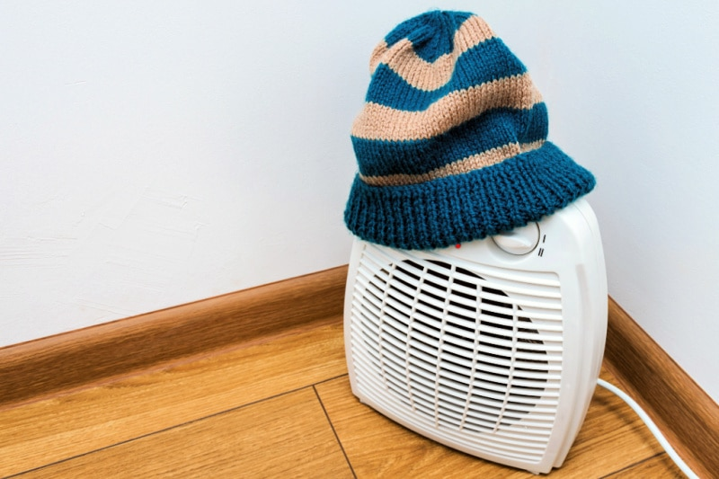 A knit hat accidentally tossed on a running space heater shows why such things do not belong in a bedroom