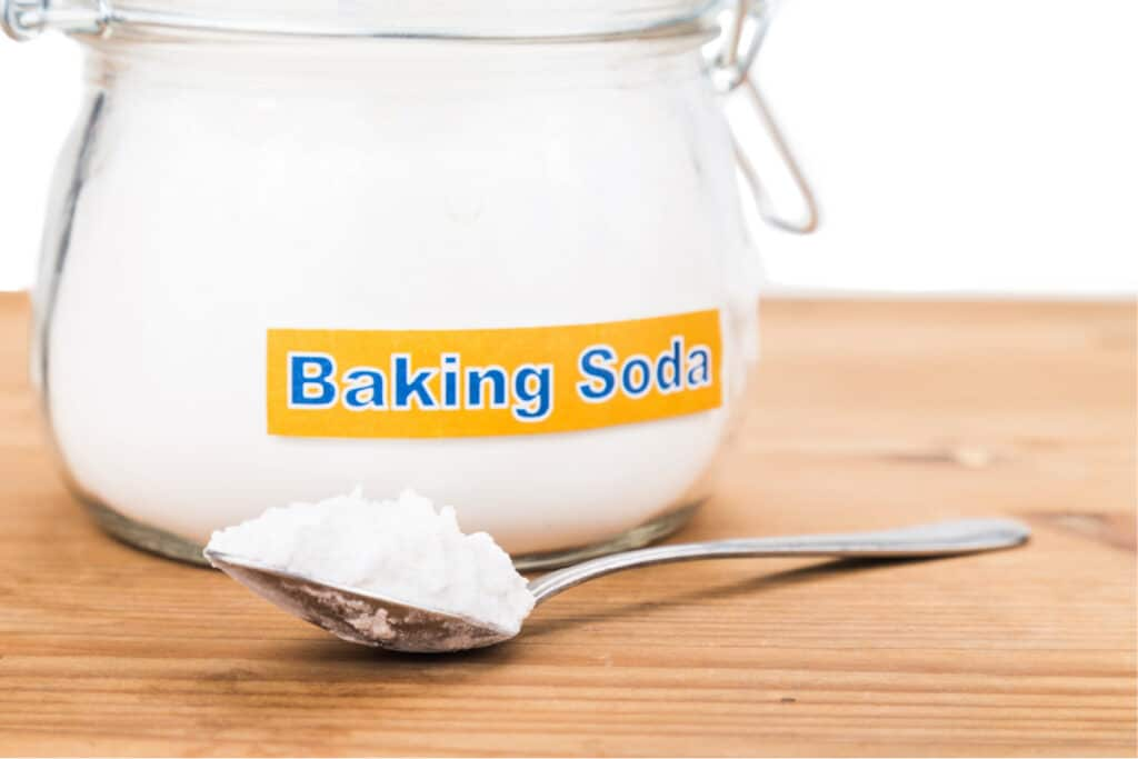 Glass fliptop jar of baking soda with label